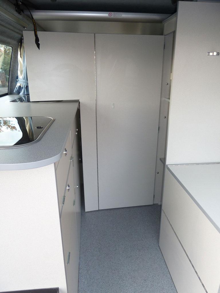 Bathroom with privacy door open in a Sanna