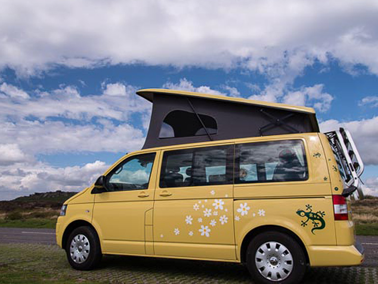 Yellow Jerba van decorated with daisies and a gecko