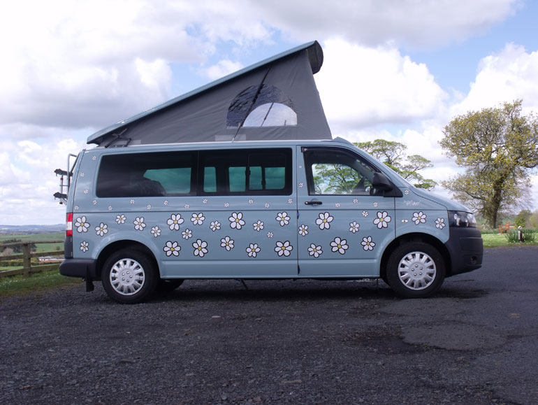 Blue van with daisies all over