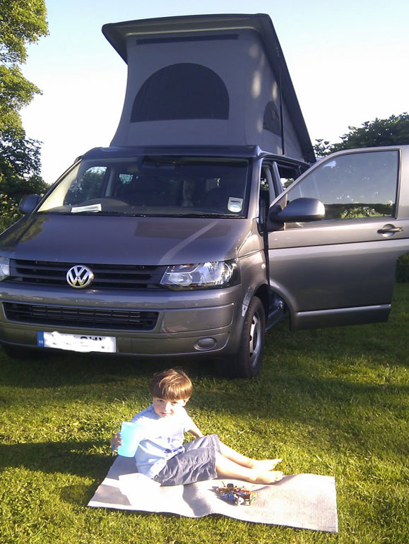 Sitting in the sun infront of the camper van