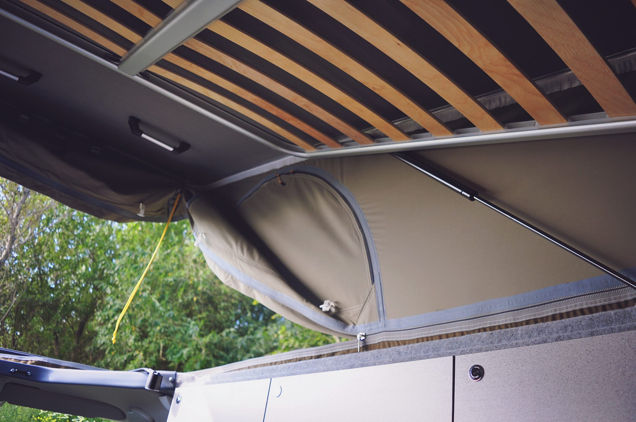 On a typical vw campervan replacing an elevating roof canvas is job that can only be undertaken by a specialist converter and would typically mean a bill
