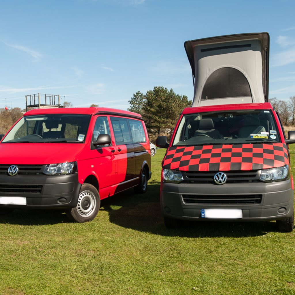 two red campervans