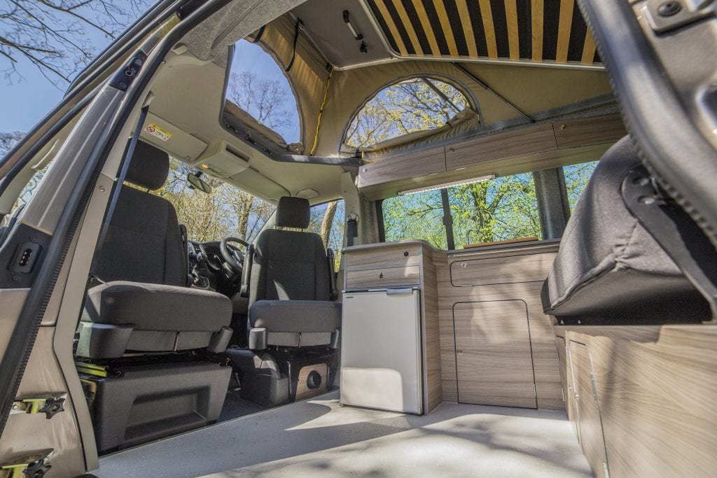 Bright Campervan Interior with seats, cupboards and windows