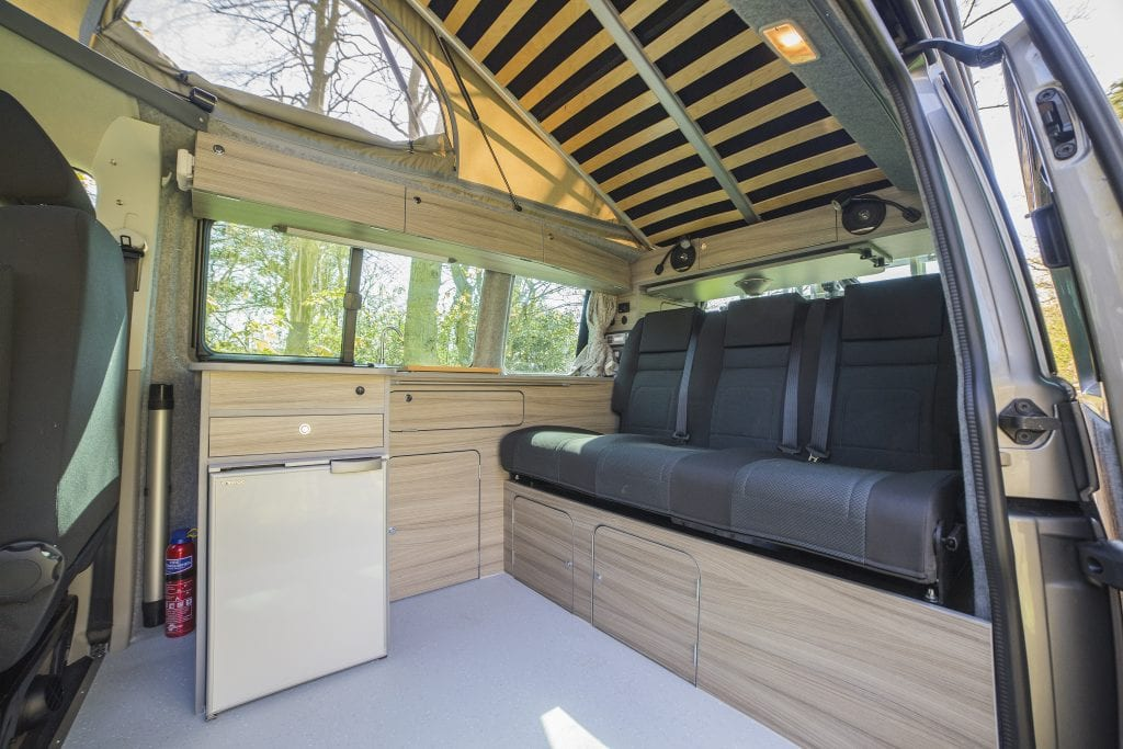 Inside the Volkswagen Tiree Campervan - Black seats and wooden interior