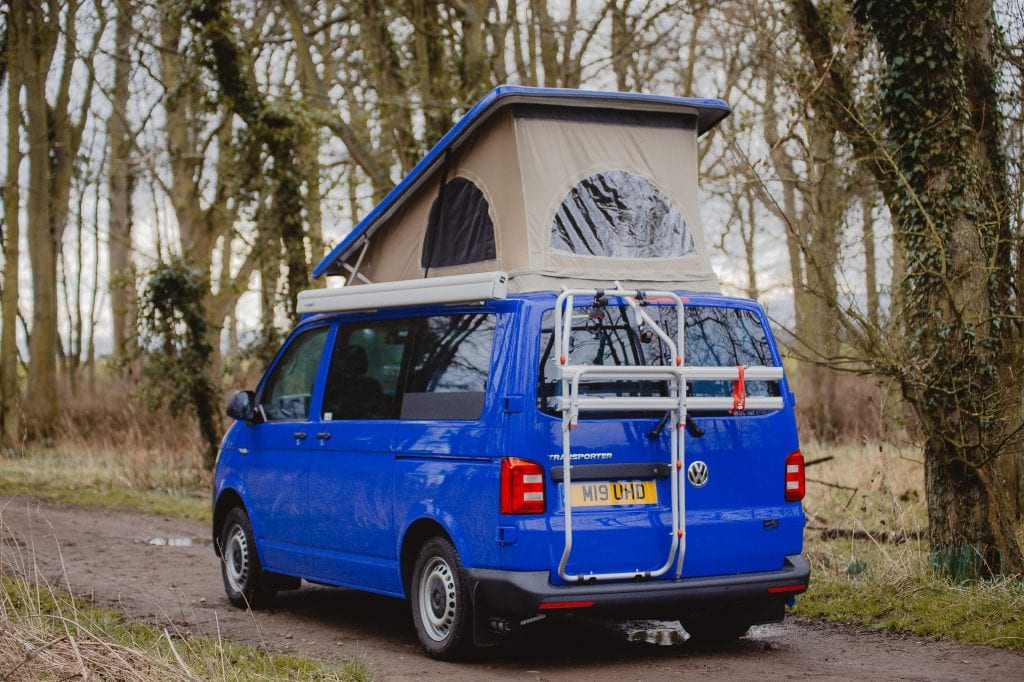 Blue Campervan with a Pop Top Roof