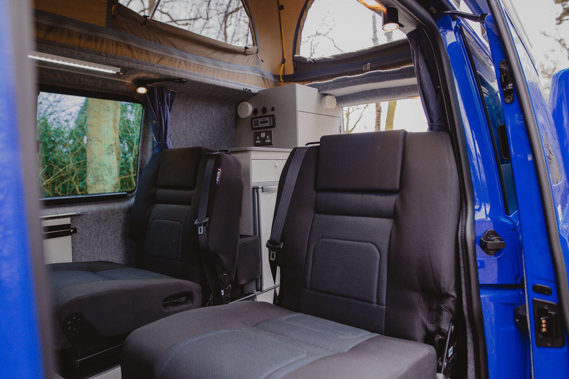Campervan Interior - Black seats in the back