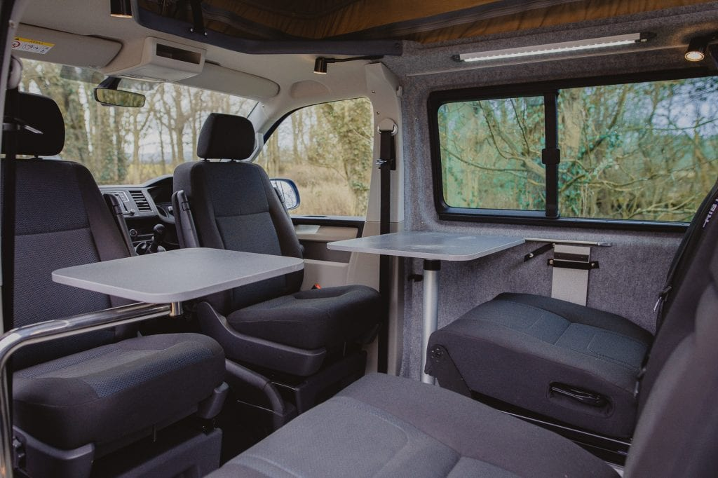 Campervan Interior - tables and seats in the middle