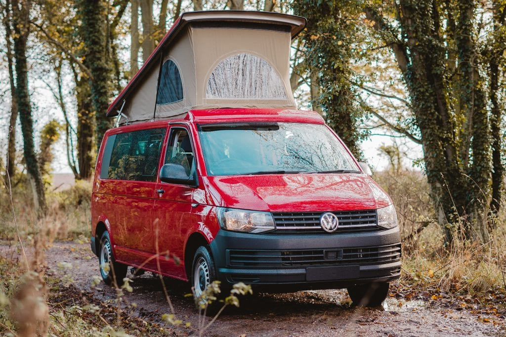 Red Campervan with a pop top roof